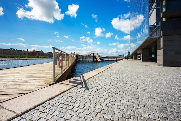 Kalvebod bridge park near river and modern office in copenhagen, denmark, scandinavia Premium Photo