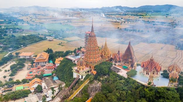 Kanchanaburi thailand with smoke from burning rice stubble on background Premium Photo