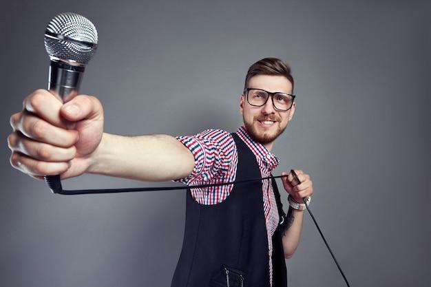 Karaoke man sings the song to microphone, singer Premium Photo