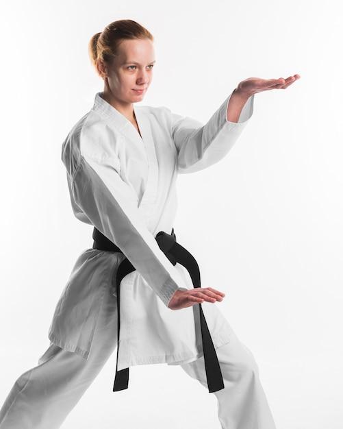Karate female fighter posing medium shot Premium Photo