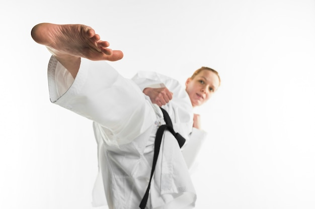 Karate fighter kicking with foot Free Photo