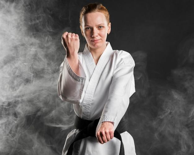 Karate fighter posing medium shot Free Photo