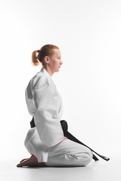 Karate fighter sitting side view Free Photo
