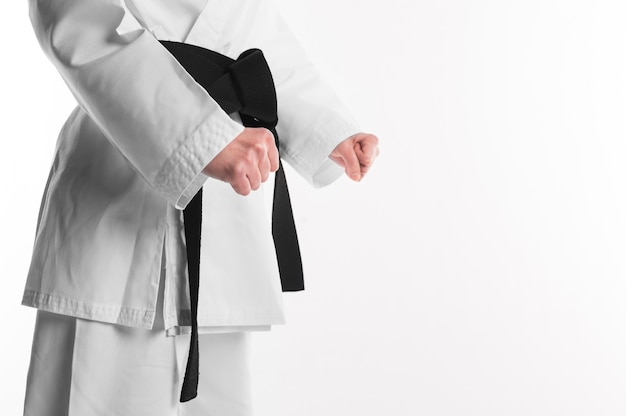Karate fighter with copy space Premium Photo