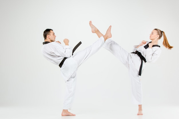 The karate girl and boy with black belts Free Photo