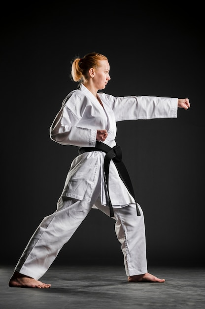 Karate girl practicing side view Free Photo