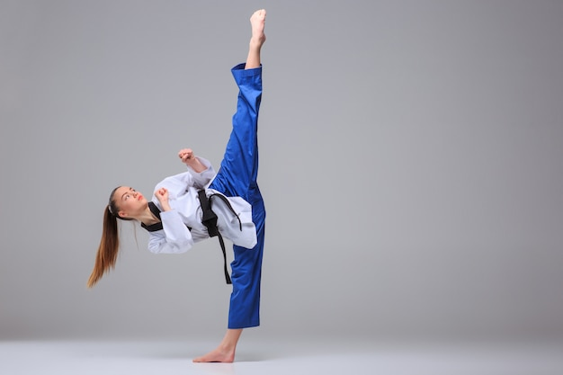 The karate girl with black belt Free Photo