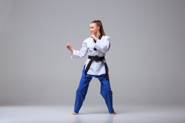 Karate girl with black belt Free Photo