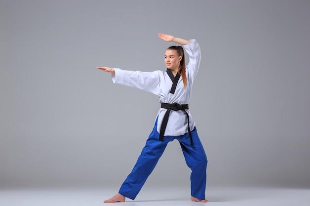 Karate girl with black belt Free Photo