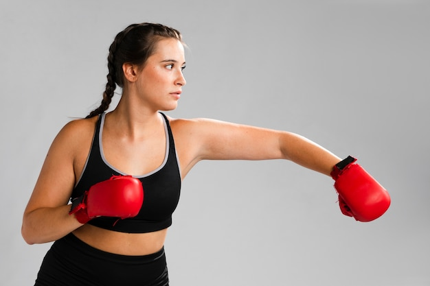 Karate punch with box gloves Free Photo