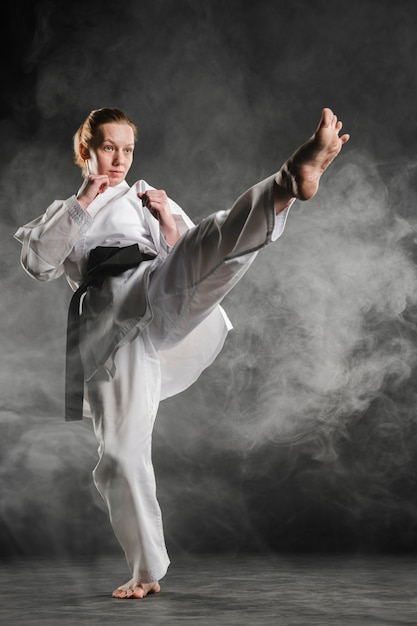 Karate woman in action full shot Free Photo
