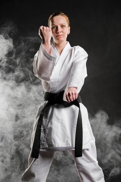 Karate woman posing front view Free Photo