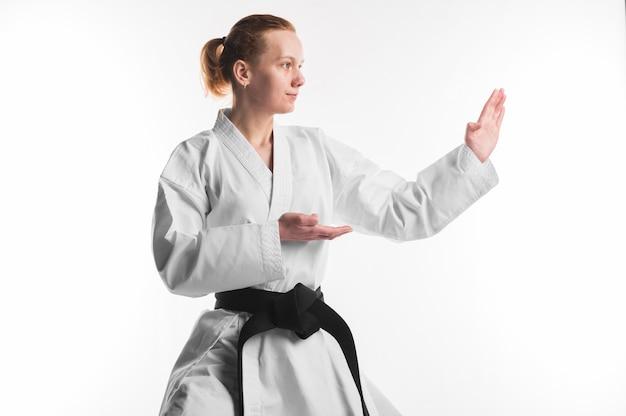 Karate woman practicing medium shot Premium Photo