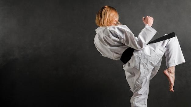Karate woman practicing side view Premium Photo