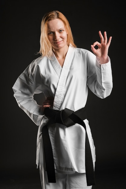 Karate woman showing ok sign Free Photo