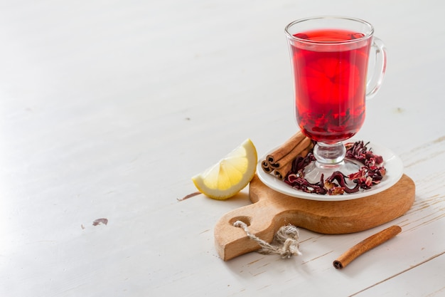Karkade tea on white wood background Premium Photo