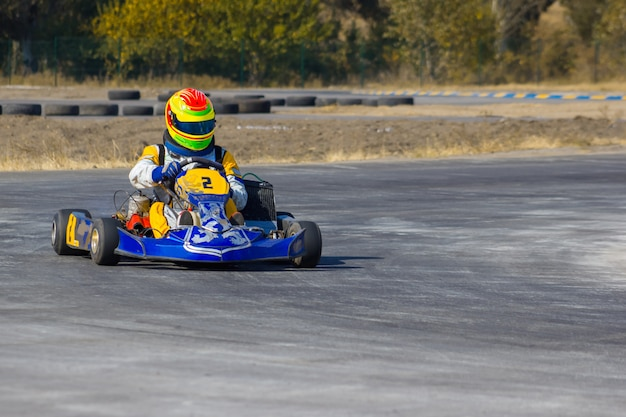 Karting driver in helmet on kart circuit Free Photo