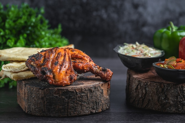 Kebab and naan bread in an artistic piece of wooden board Premium Photo
