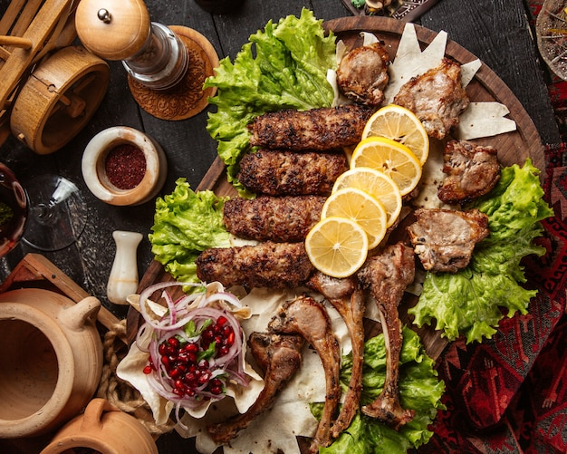 Kebab set with various meat pieces and lemon slices Free Photo