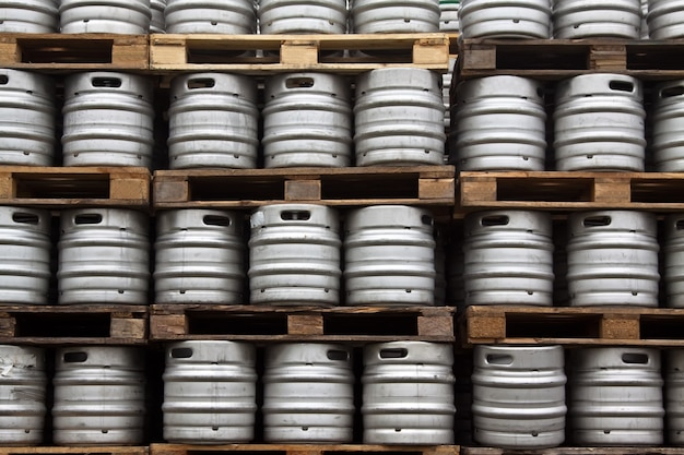 kegs of beer in regular rows Free Photo
