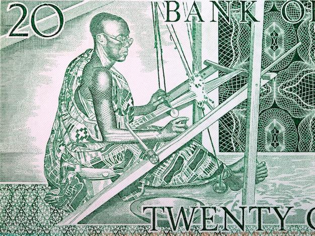 Kente weaver from old ghanaian money Premium Photo