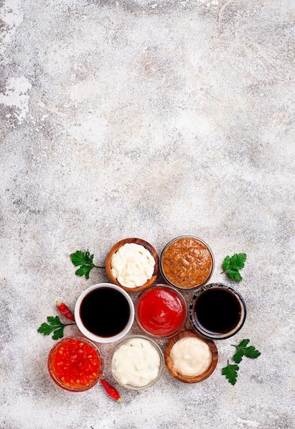 Ketchup, mayonnaise, mustard, horseradish, soy sauce and tartar Premium Photo