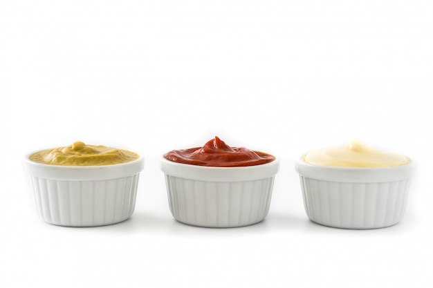 Ketchupmustard and mayonnaise in a bowls isolated on white background Premium Photo