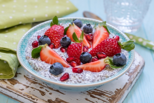 Keto ketogenic, paleo low carb diet not oatmeal breakfast porridge. coconut chia pudding with berries, pomegranate seeds and almond Premium Photo