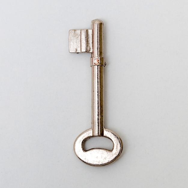 Key isolated on white background. Premium Photo
