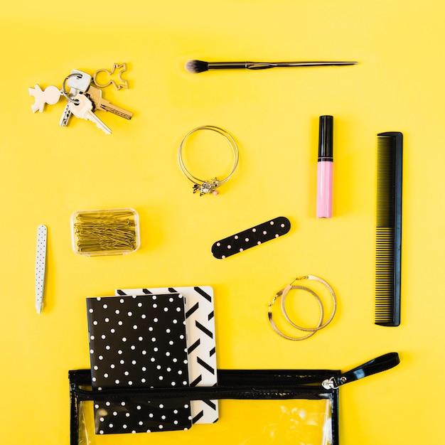 Keys and beauty supplies near cosmetics bag Free Photo