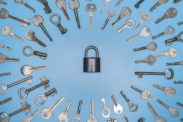Keys set and lock concept, blue background, protection of business and home Premium Photo