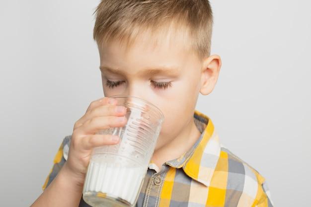 Kid drinking milk with glass Free Photo