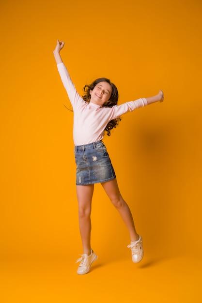Kid girl jumping happy girl dancing Premium Photo