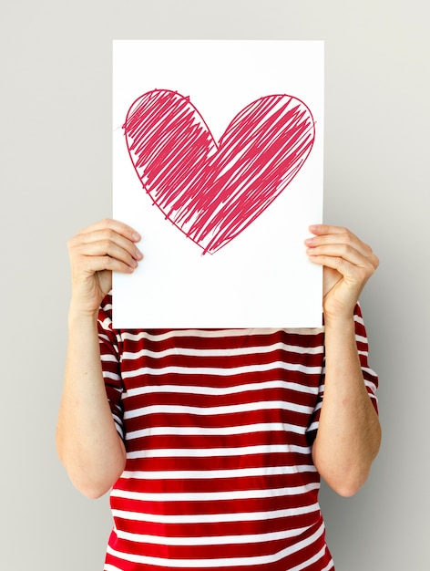 Kid holding heart icon on a paper Free Photo