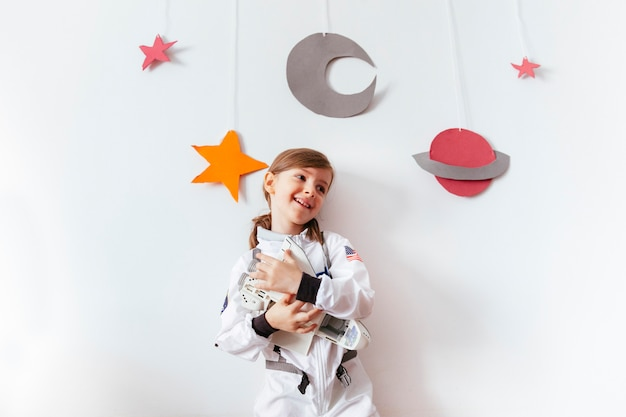 Kid on a home made galaxy playing at home Premium Photo