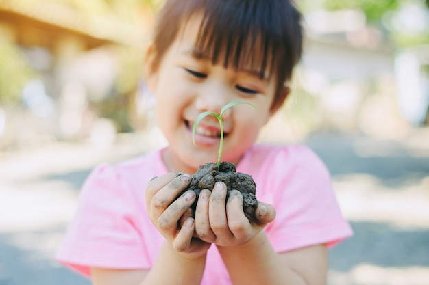 Kid planting a tree for mother earth day concept. Premium Photo