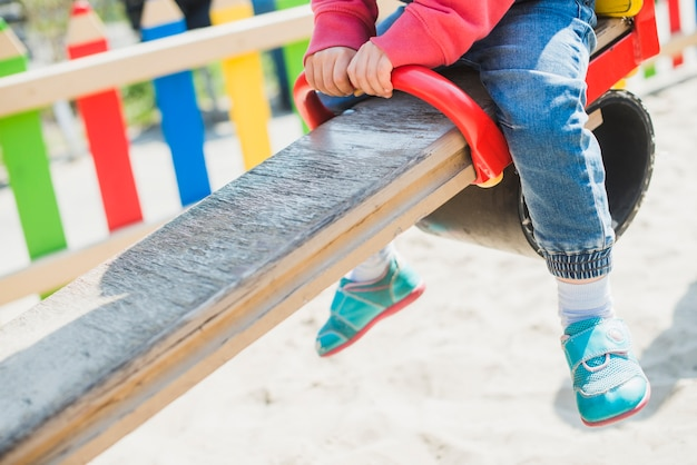 Kid playing outside on playground Free Photo
