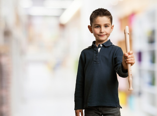 Kid posing with a flute Free Photo