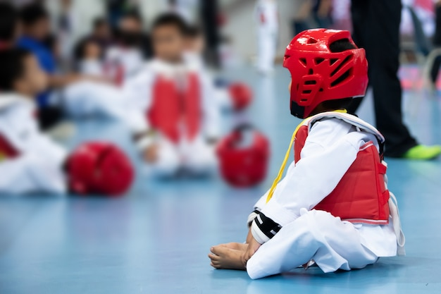 Kid sport athlete taekwondo with protective gear warm up before fight Premium Photo