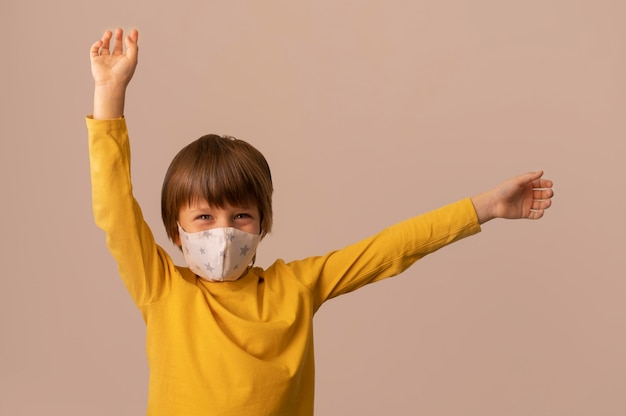 Kid wearing a medical mask Free Photo