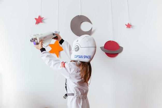 Kid with a hand made galaxy at home Premium Photo