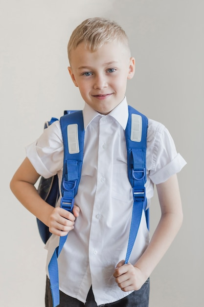 Kid with rucksack in studio Free Photo