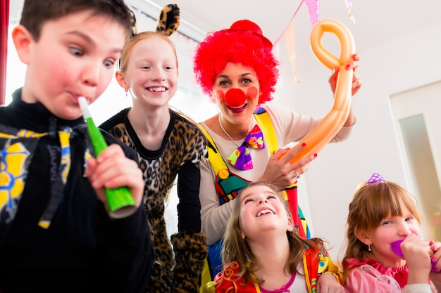 Kids birthday party with clown and lot of noise Premium Photo