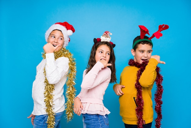 Kids celebrating crhistmas day doing expressions Premium Photo