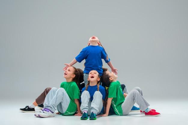 Kids dance school, ballet, hiphop, street, funky and modern dancers Free Photo