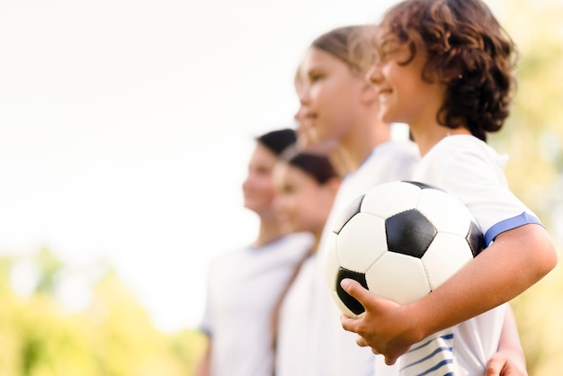 Kids getting ready for a football match with copy space Premium Photo