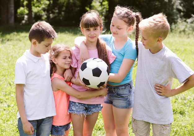 Kids getting ready for a football match Free Photo