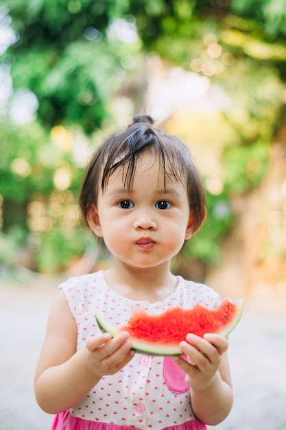 Kids having fun and celebrating the hot summer holidays by eating watermelon Premium Photo