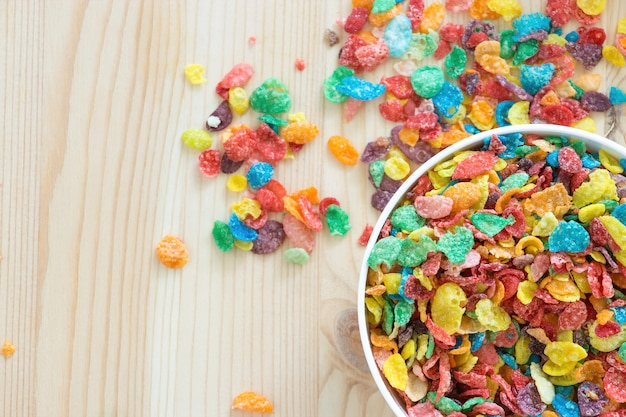 Kids healthy quick breakfast. colorful rice cereal on wooden background. copy space Premium Photo