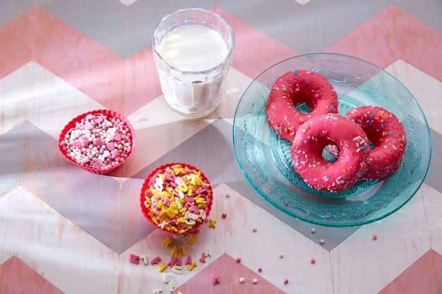 Kids party with milk pink donas and cupcake topings Premium Photo
